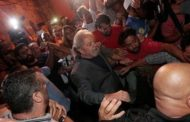 Brazil's Lula surrenders to police to begin jail sentence after tense showdown